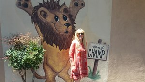 Sandra Smith in front of a Little Lake Elementary School sign.