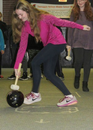 Middle school students do a broom-ball type experiment to learn about force and motion.