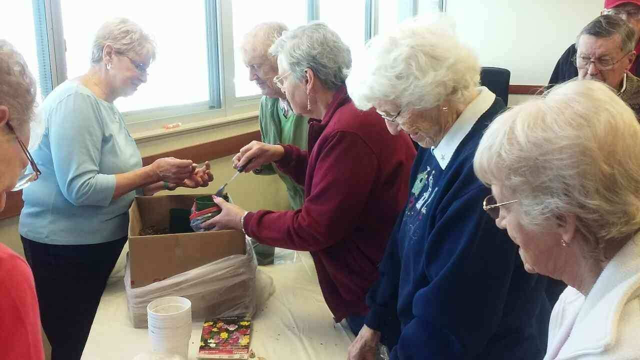 The local garden club shows seniors spring planting tips.