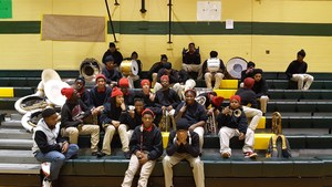 Photo of the Baker middle Band on stadium seats at the Washington-Marion Battle of the Bands