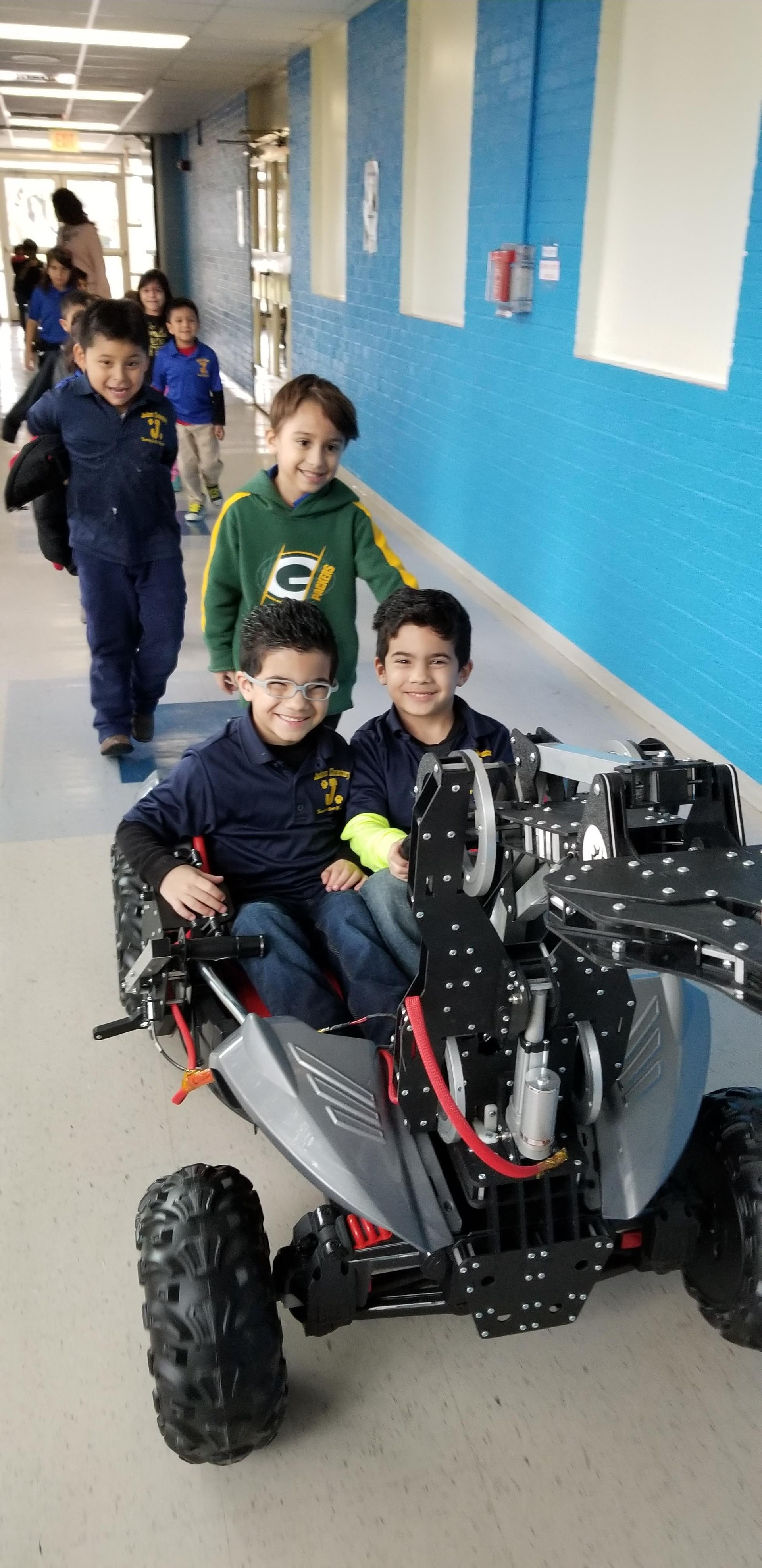 students riding rover