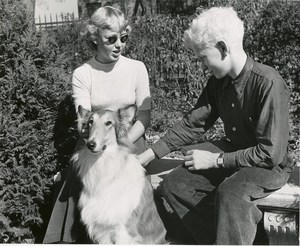 Two students with a collie dog