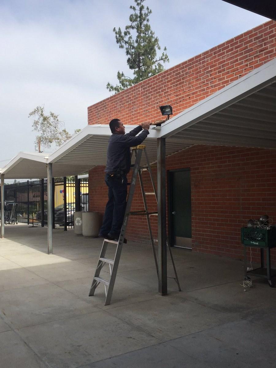 Worker fixing lights