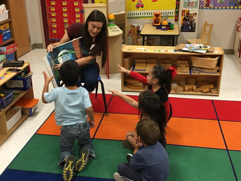 Parents surprised PreK students and read to classes.