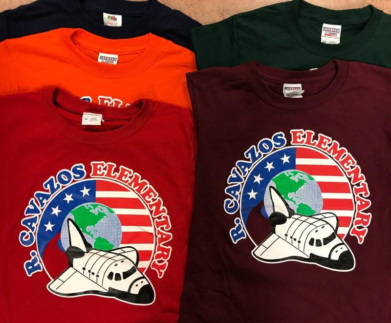 picture of five different colored shirts with school logo