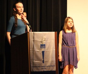 NJHS inductee, Molly Tichacek, is introduced during the induction ceremony on March 22, 2018.