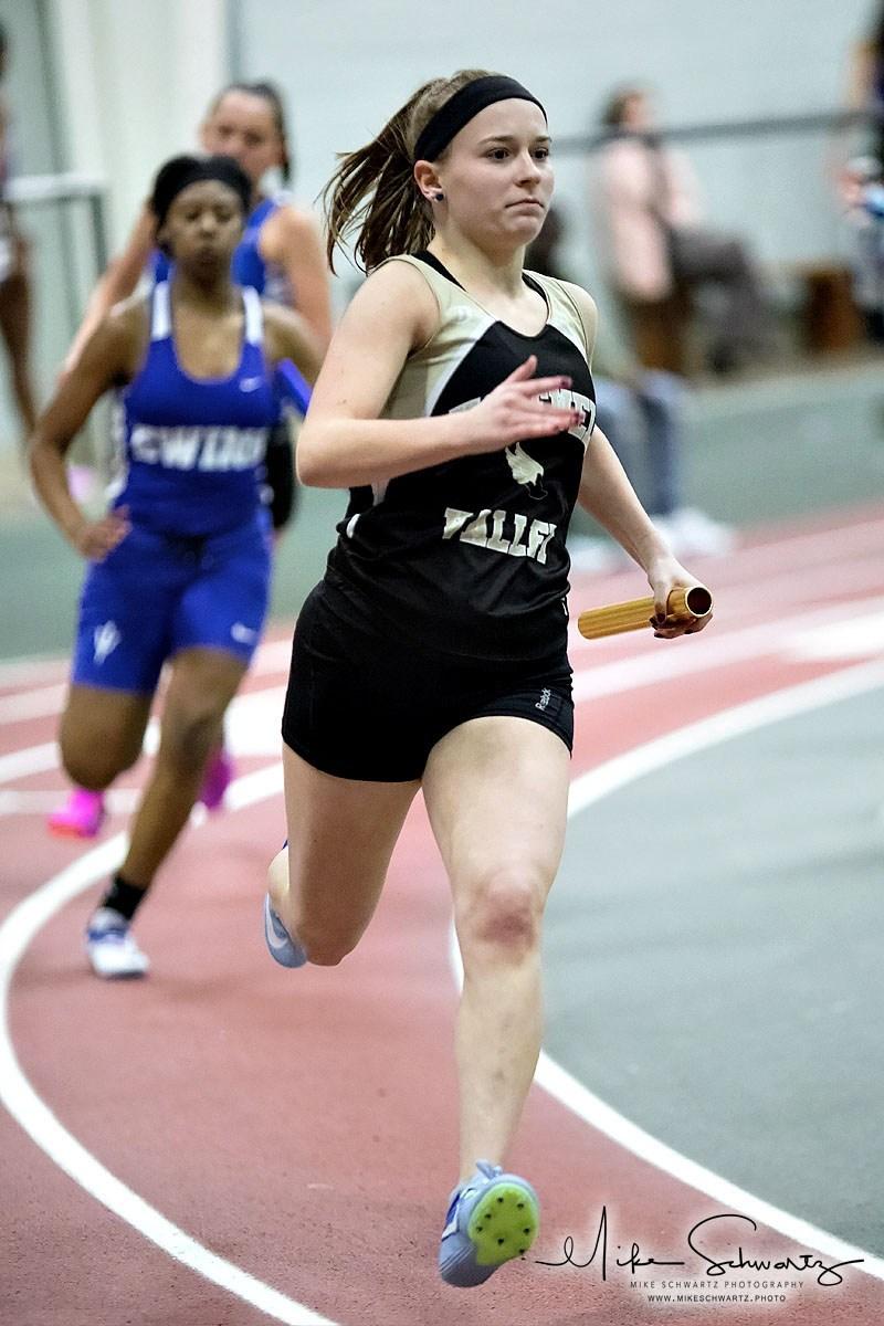 CHS girls relay runner rounds a curve