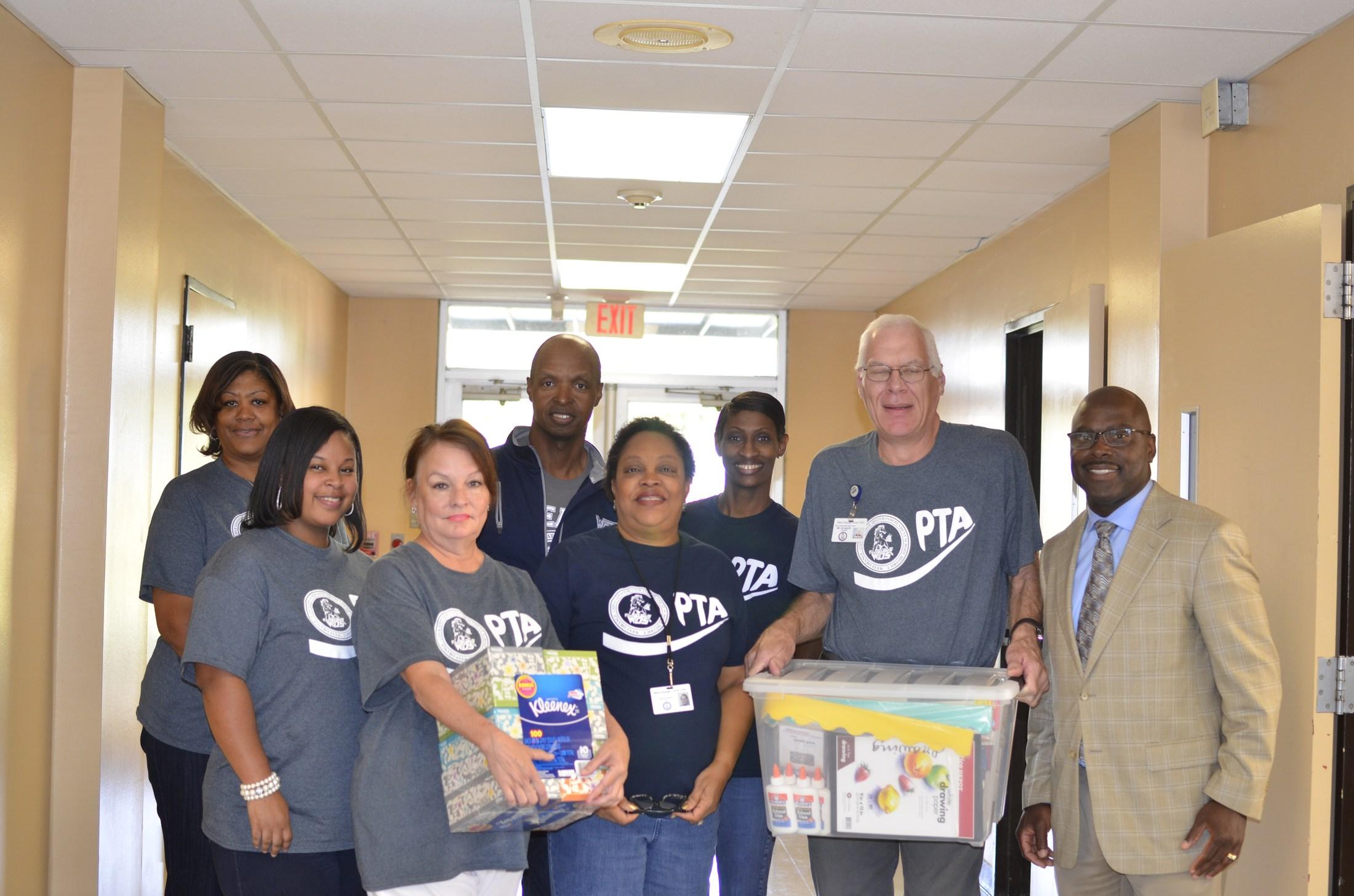 AAC staff along with Superintendent, Mr. Harris, and Parliamentarian, Linda Bryant, receiving PTA award.