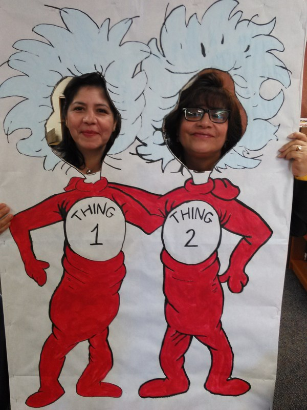 Santa Fe Elementary School parent volunteers Martha Cardenas and Eloisa Jimenez greet guests for Dr. Seuss festivities in a Thing 1 and Thing 2 cutout for Read Across America.