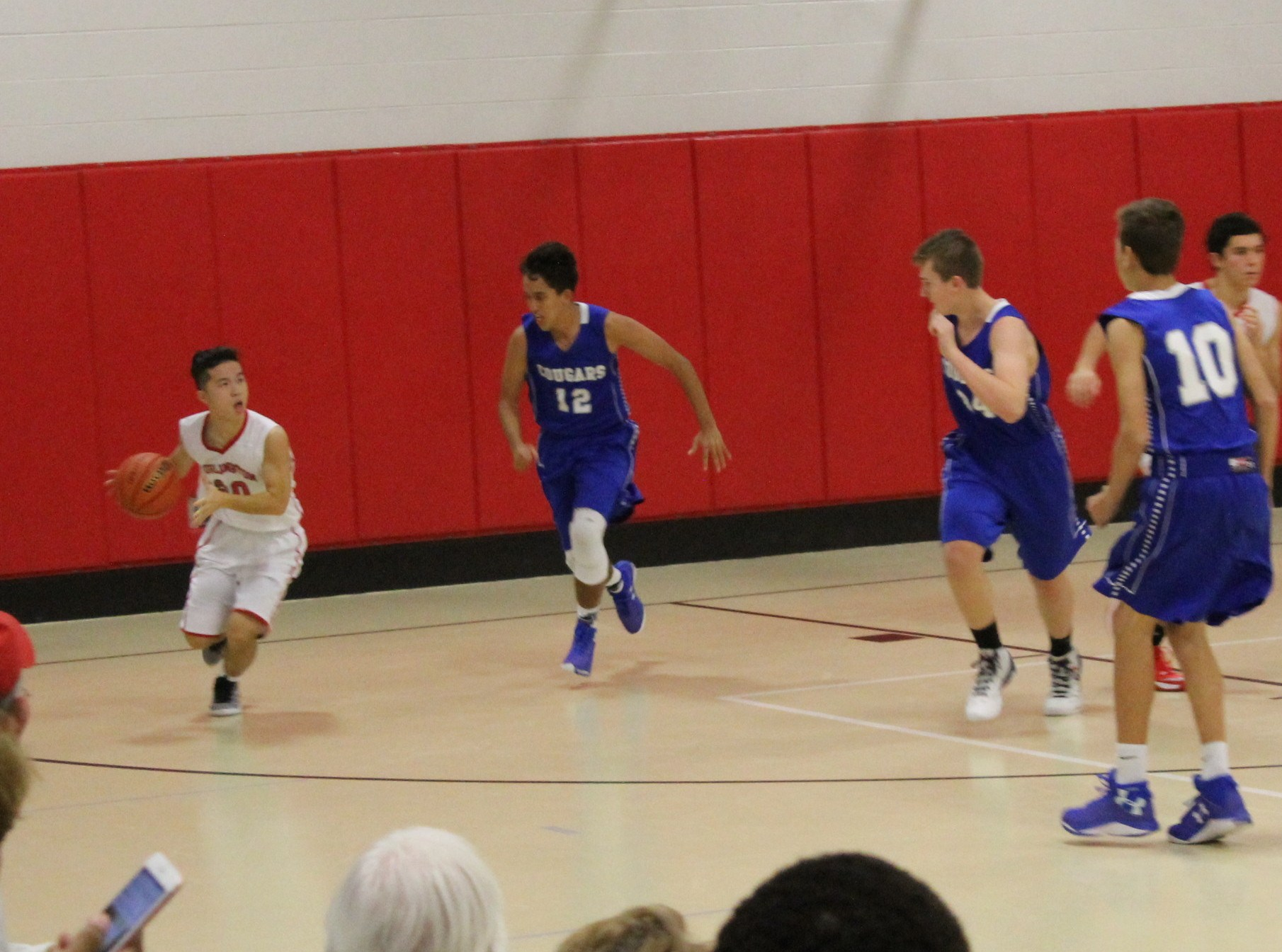 Exchange student playing in JV basketball game.