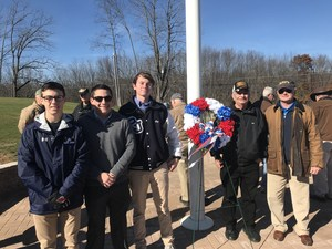 Peter Corcoran, group pose during flagpole ceremony