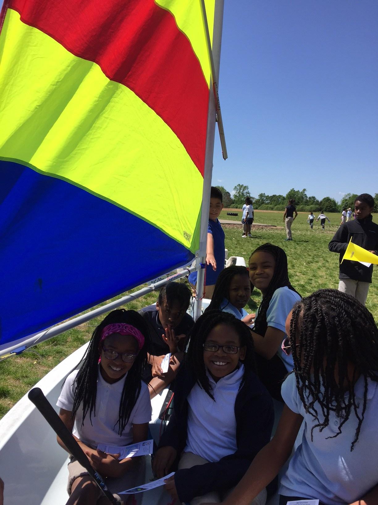Students in backyard sail boat