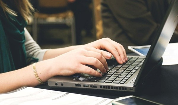 A student typing on a laptop