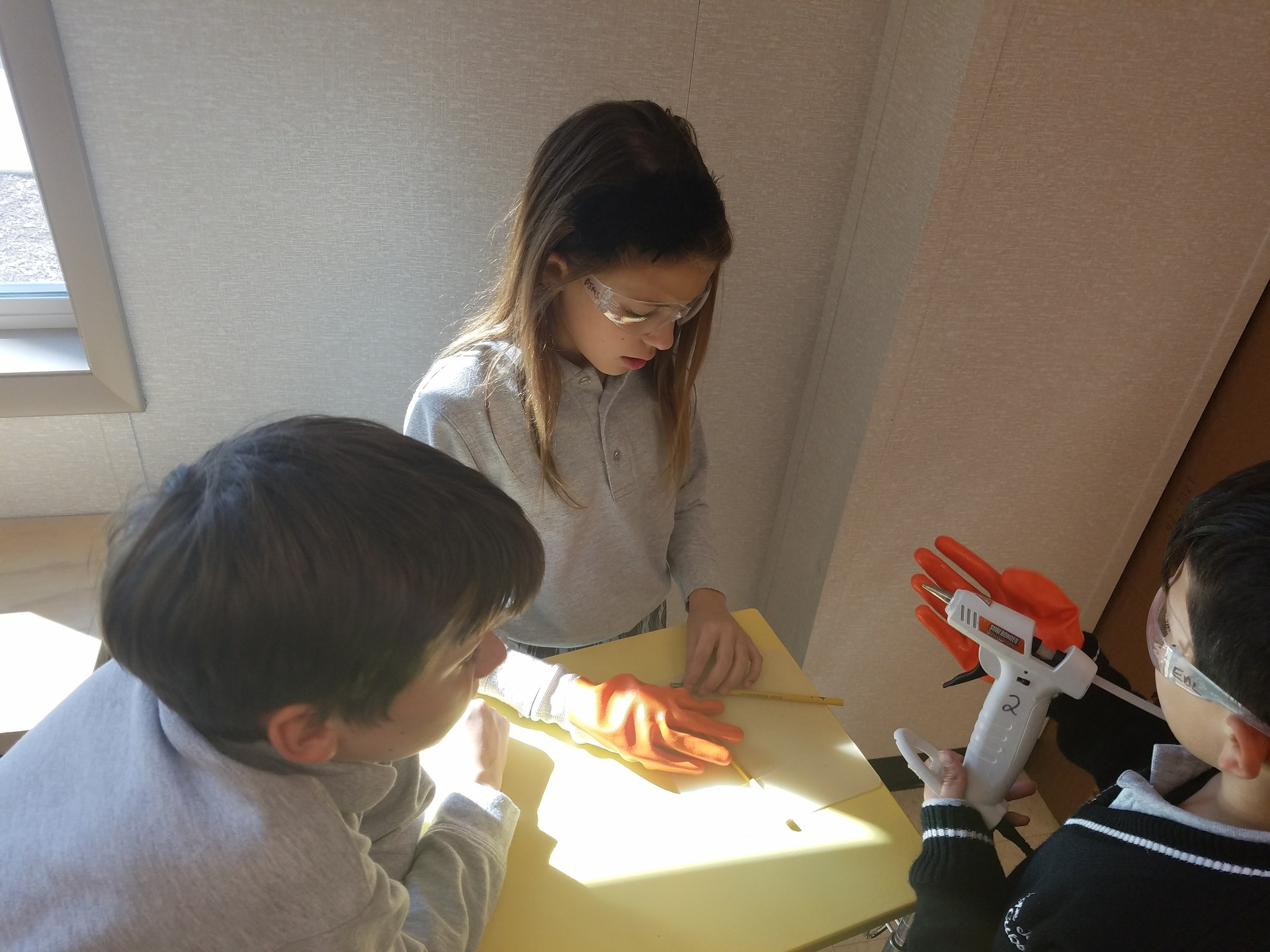 Two students creating toy