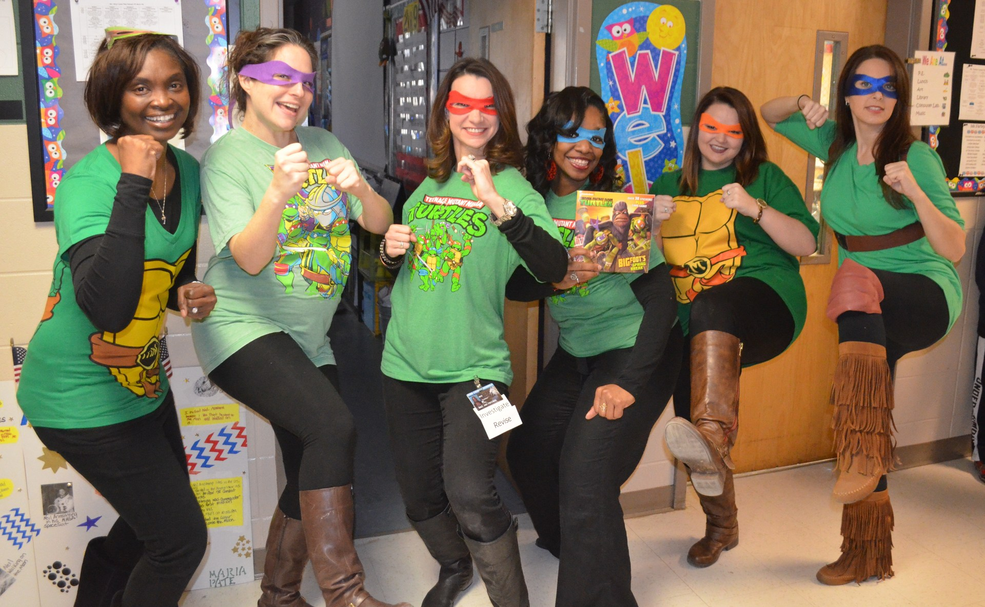 Second grade teachers get into the spirit of Read Across America Day by suiting up as Ninja Turtles.