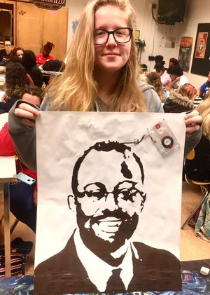 Savannah Lee was one of the students at Smithfield High School honored with an Isle of Wight Achievement Award by winning the Virginia School Board Art contest in the High School category out of all of Virginia. Here she is with another of her cassette tape portraits