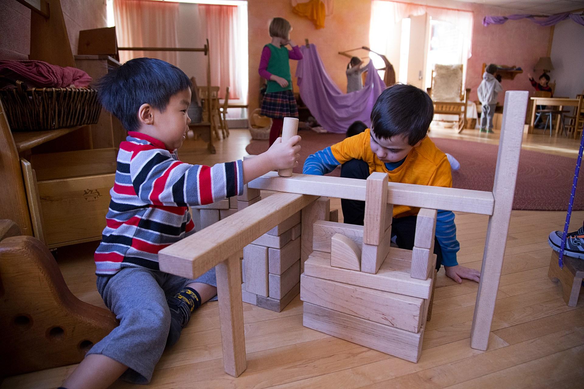 PreK boys playing with blocks