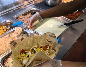 Building a taco salad bowl at the global Fiesta bar