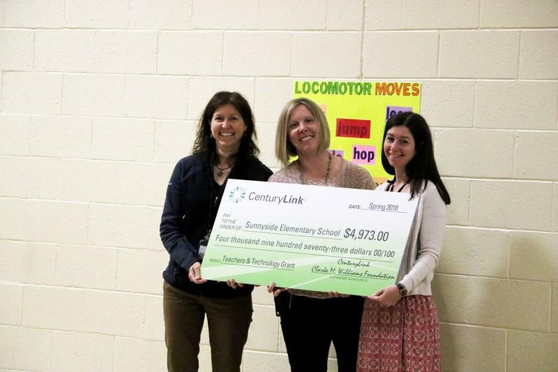 Sunnyside teachers receive check from CenturyLink.