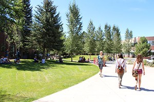 Students walking on school campus during the summer.