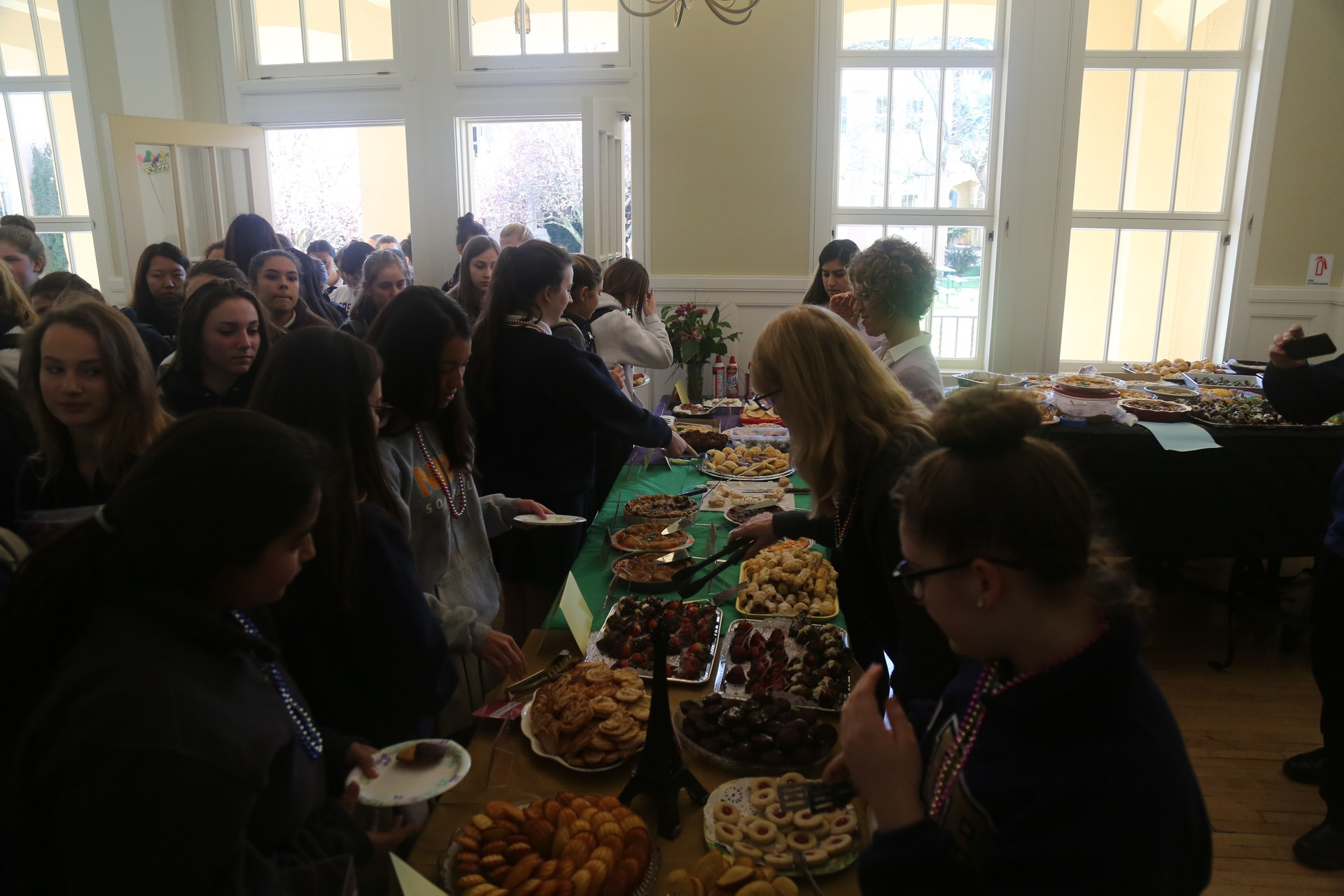 Students waiting for desserts at French Luncheon