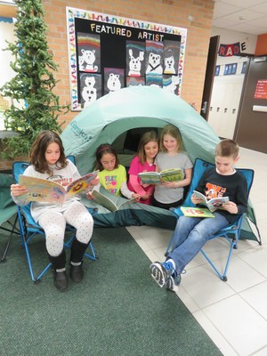 Visitors at Lee's Camp Read-A-Lot find a tent and some camp chairs as a perfect place to sit down and read.