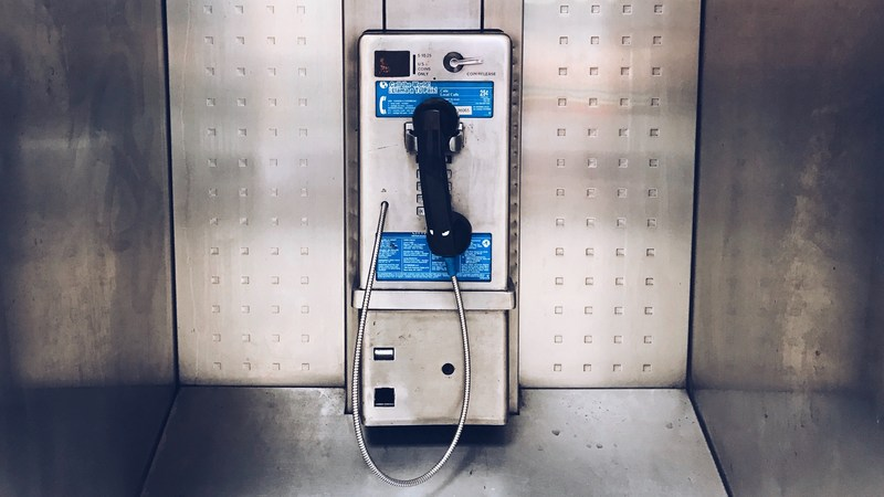 Photo of an old pay phone.