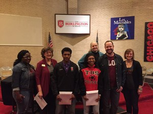 Mari and Izayiah pose with Elon Academy Employees