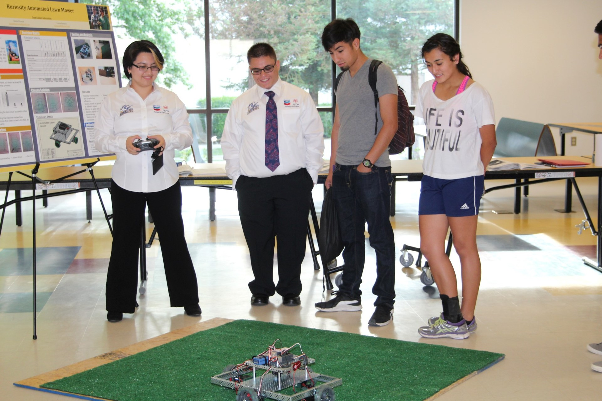 students demonstrating robot in engineering class