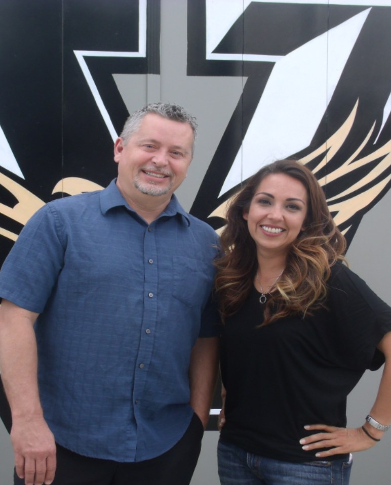 photo of our counselors, Mr. Robison and Ms. Lopez, together in front of the Vista logo.