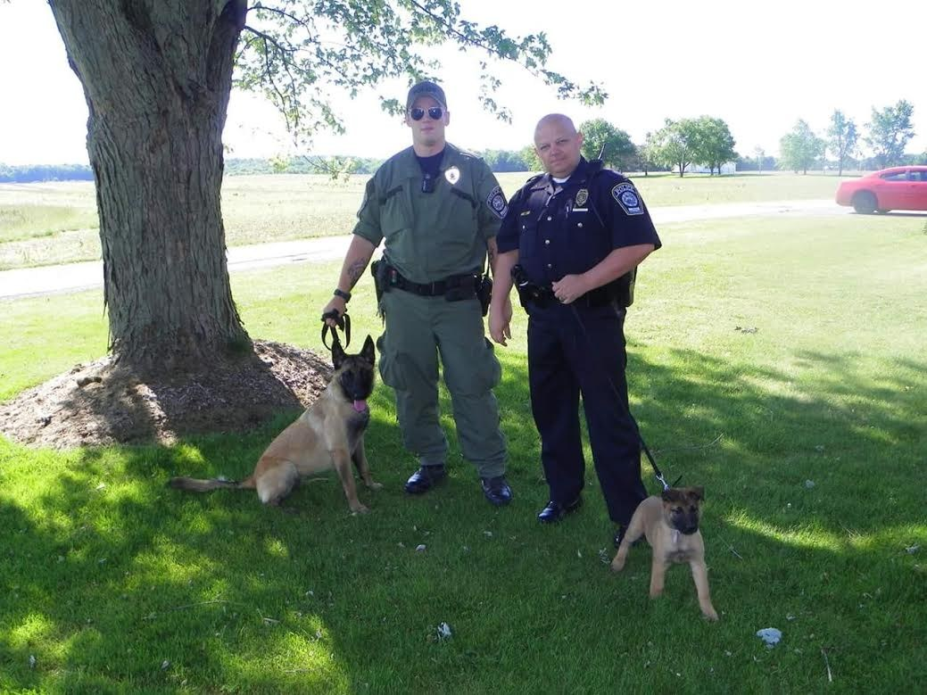 Chief Ryals and Officer Seth Meyer with k9s
