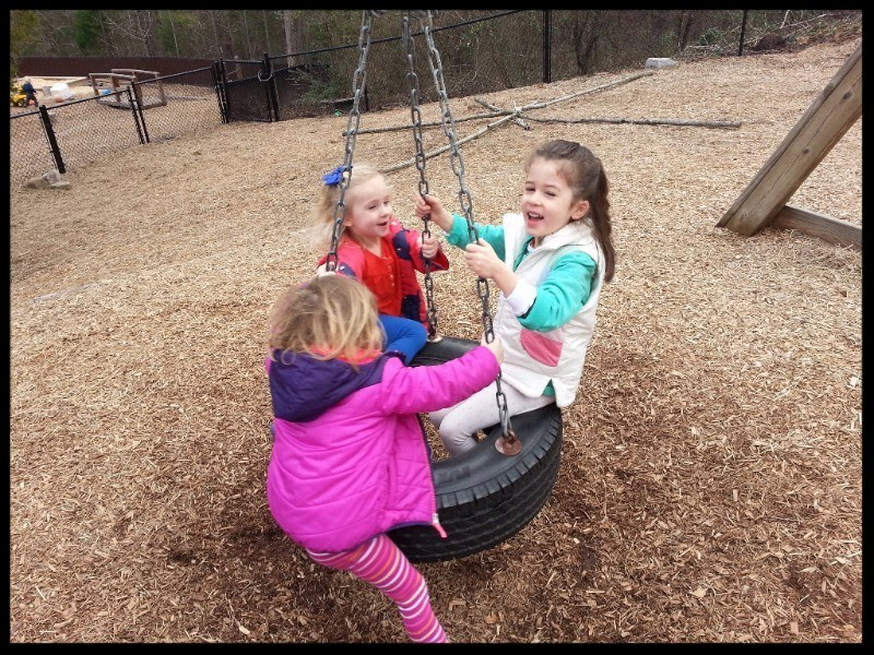 3 girls on tire swing