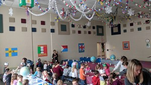 Alamo students enjoy their holiday snack in the cafeteria decorated for christmas around the world.