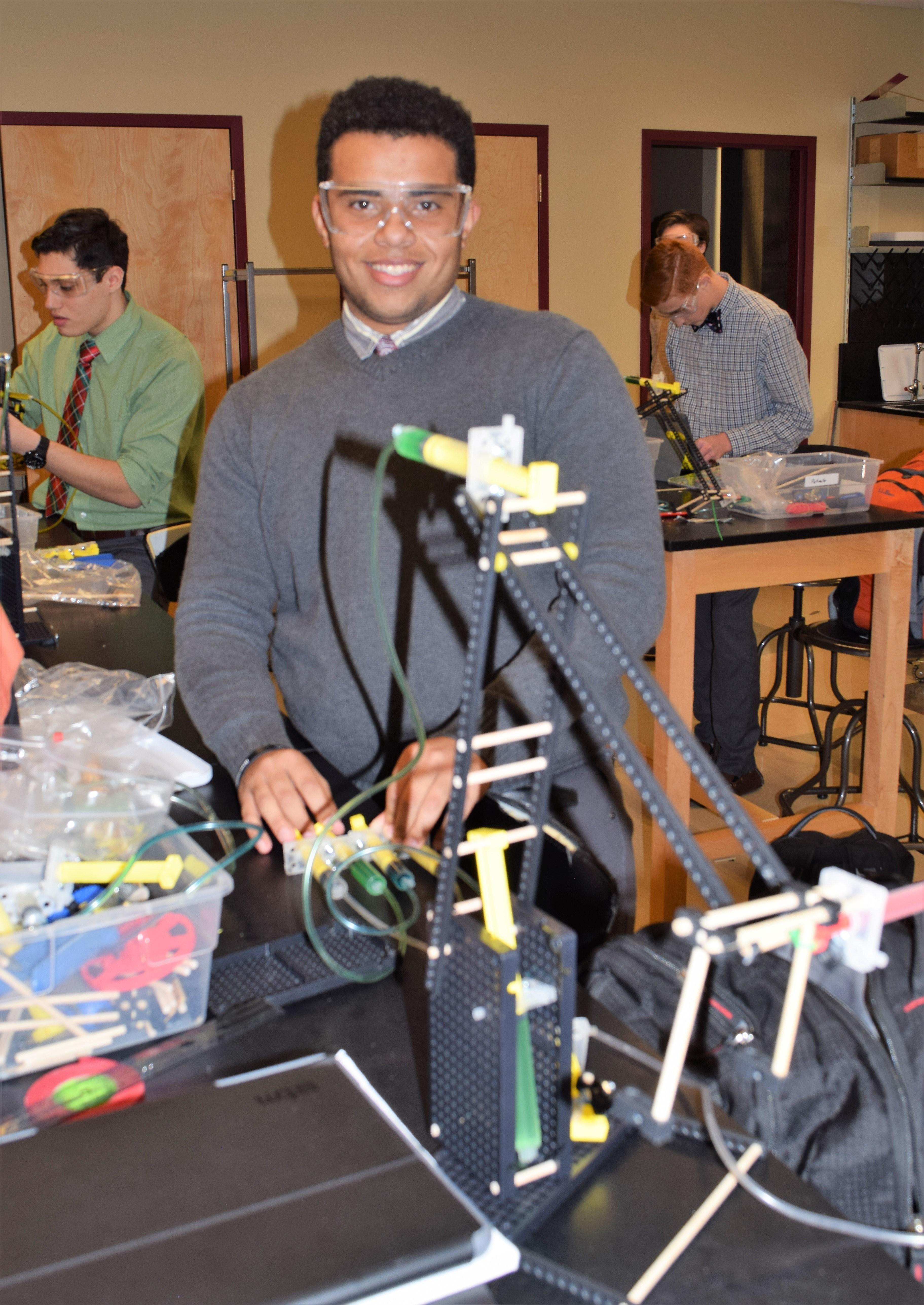 student with robotics