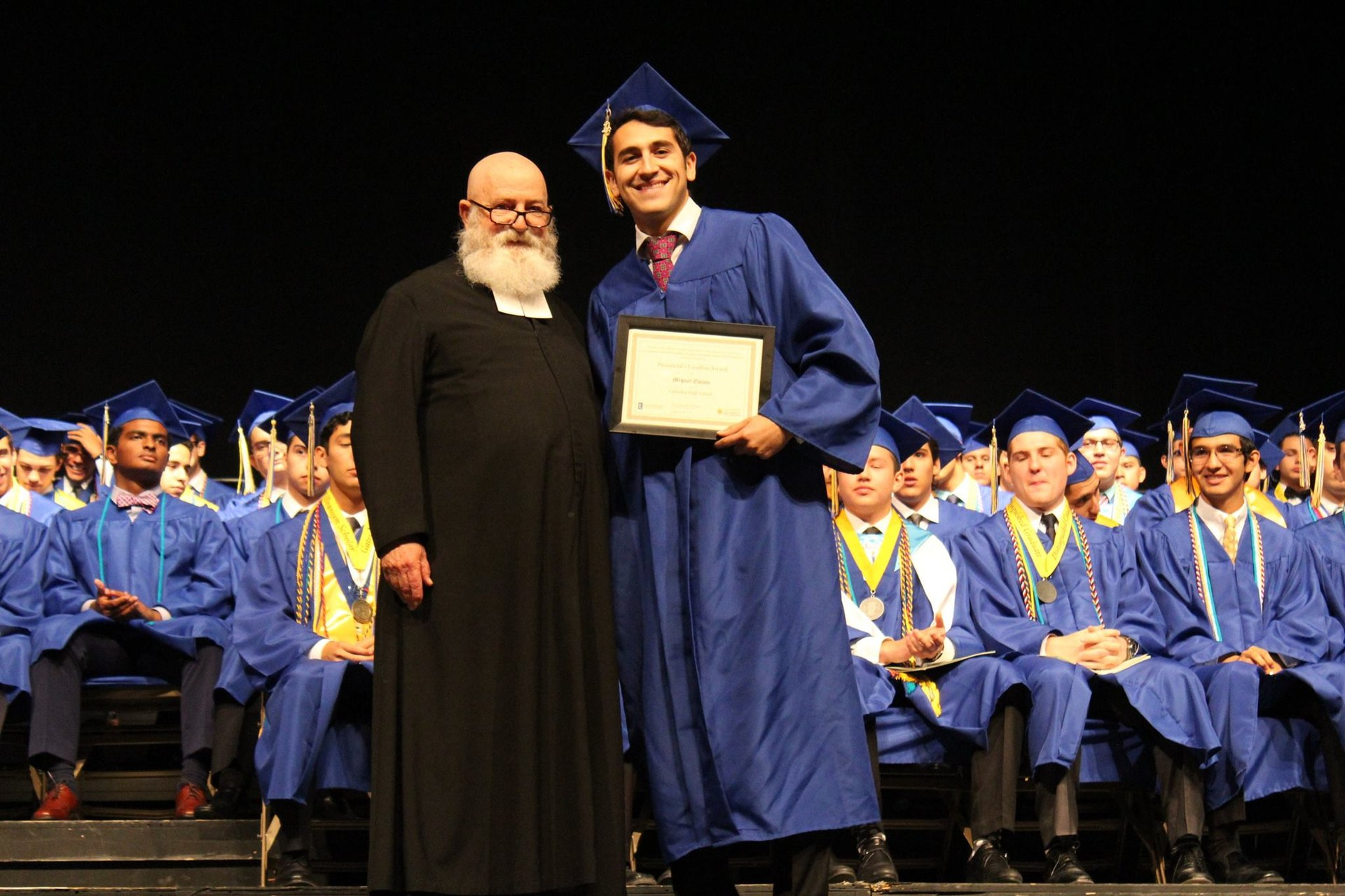 Miguel Escoto '16 receiving Cathedral's De La Salle award