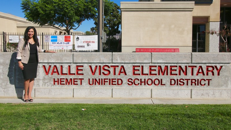 Christine Ramirez in front of the Valle Vista Elementary sign