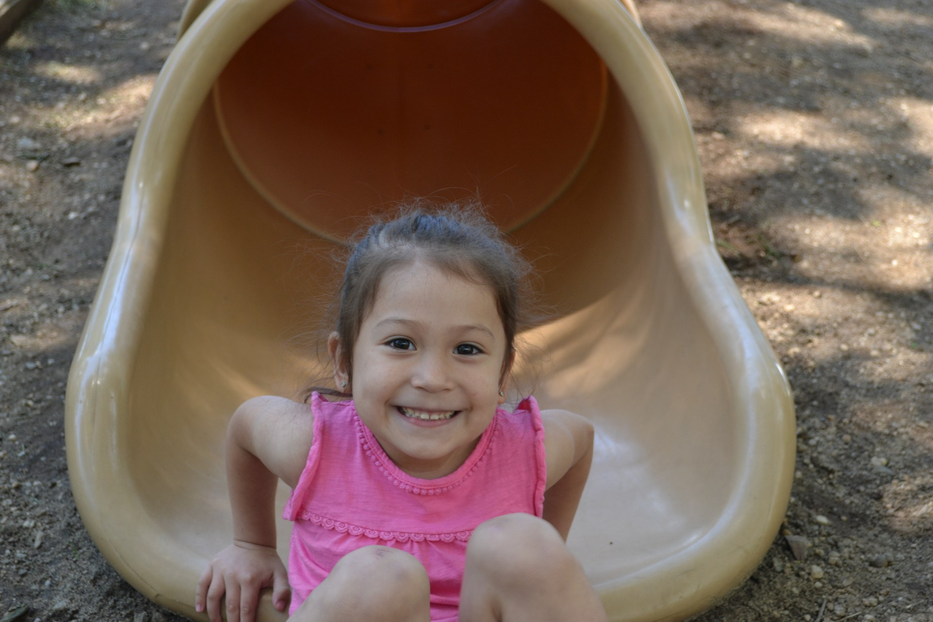 Girl coming down slide