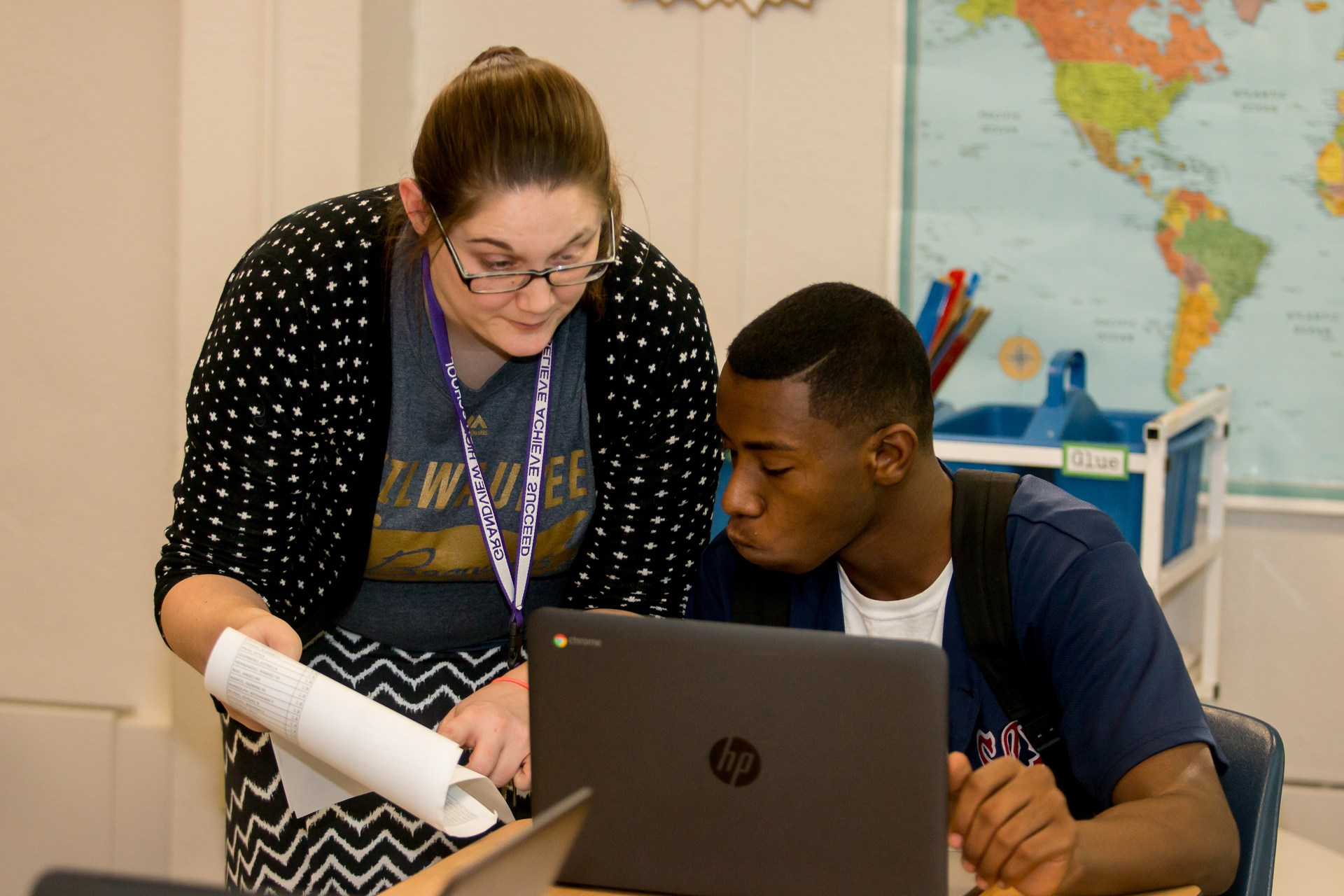 Student working with staff member