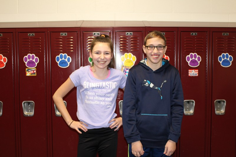 photo of sixth grade boy and girl in front of lockers