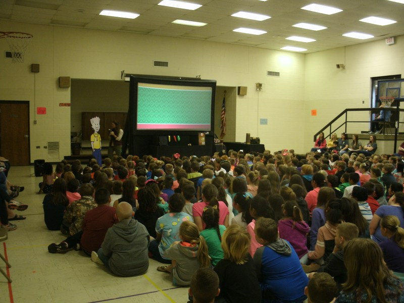 Students attending the NED  character education assembly in the gym.