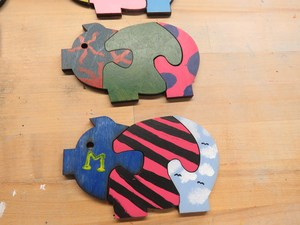 Pig puzzles painted by TK Art Club.