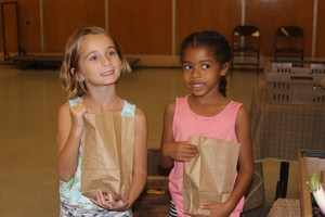 Clegg students holding bags of produce