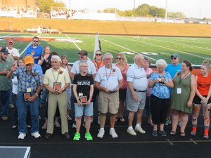 Five distinguished Thornapple Kellogg High School alumni were honored by the Alumni Association at the Homecoming game.