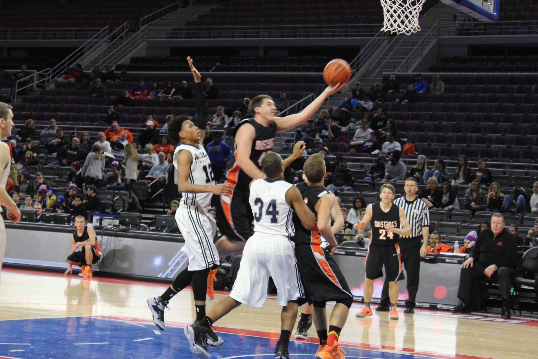 Action photo of boys varsity basketball game played at Palace of Auburn Hills