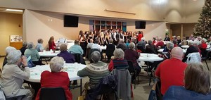 Senior citizens enjoy a holiday luncheon with entertainment from the TK Honors Choir.