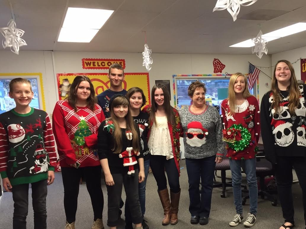 Photo of students wearing silly holiday shirts at the