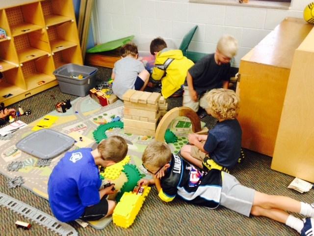 Boys building a city together.