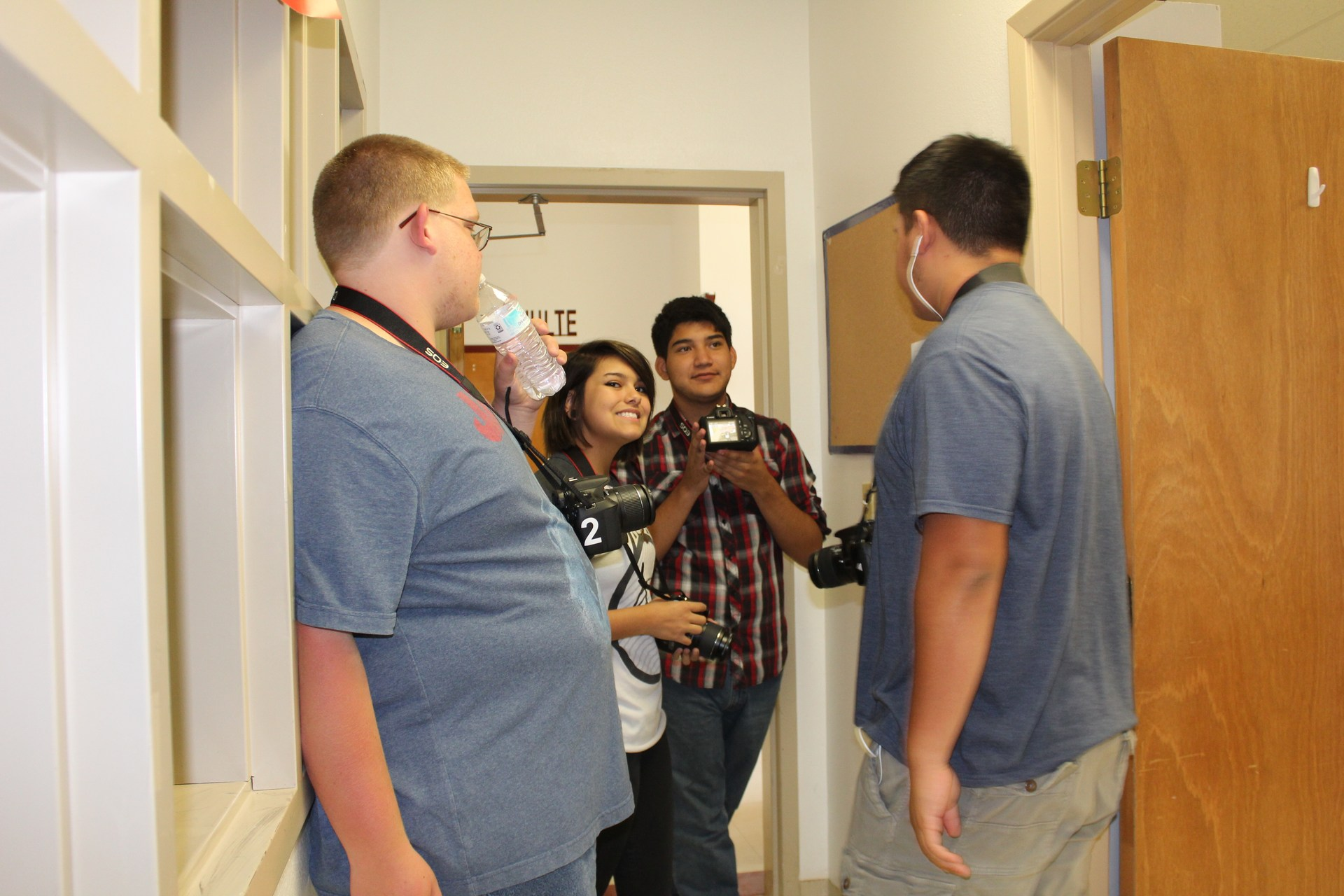 Students taking photos in hall