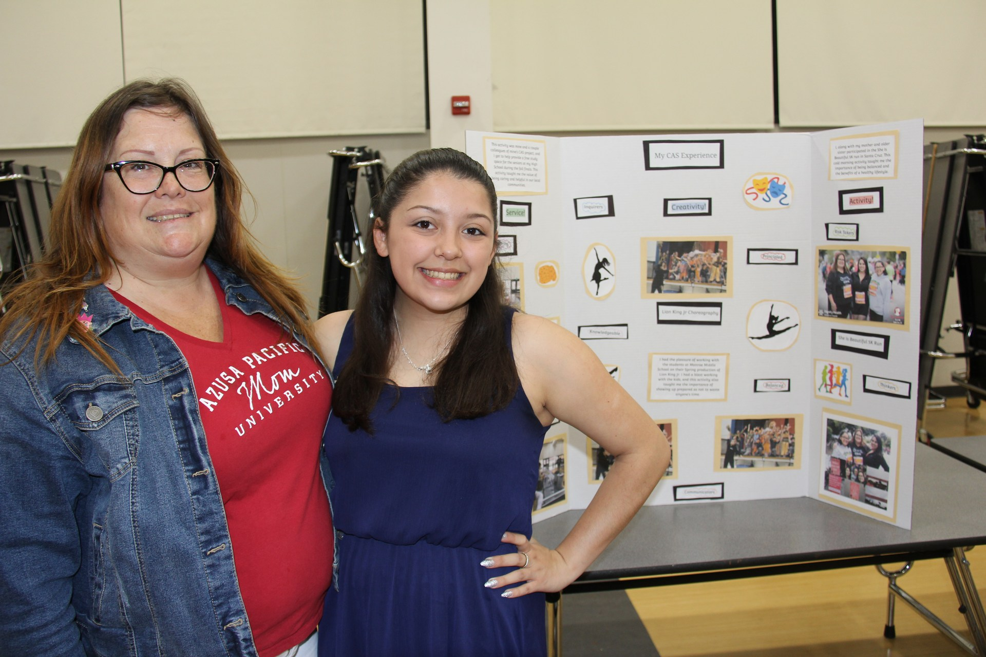 Image of IB Diploma Candidate with her Mom and presentation board at CAS Celebration Event