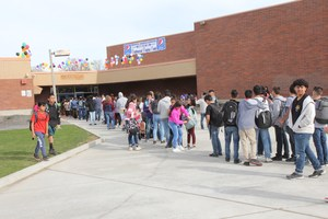 Line of people waiting outside of the Middle School for the start of CUF